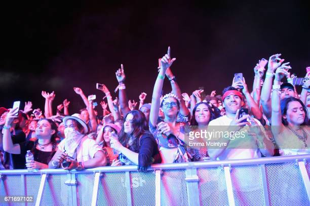 Festivalgoers watch rapper ScHoolboy Q perform at the Outdoor Theatre during day 2 of the 2017 Coachella Valley Music Arts Festival at the Empire...