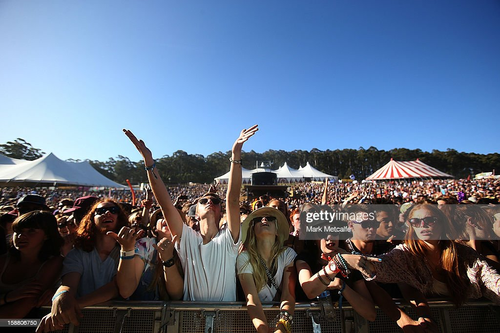 Festival-goers watch SBTRKT perform at the Valley Stage at The Falls Music and Arts Festival on December 30, 2012 in Lorne, Australia.