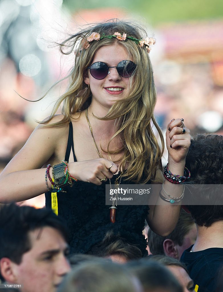Festivalgoers watch the Ben Howard on day 3 of the Isle of Wight Festival at Seaclose Park on June 15 2013 in Newport Isle of Wight