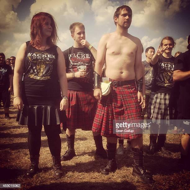 Festivalgoers wearing kilts attend the 2014 Wacken Open Air heavy metal music festival on on July 31 2014 in Wacken Germany Wacken is a village in...