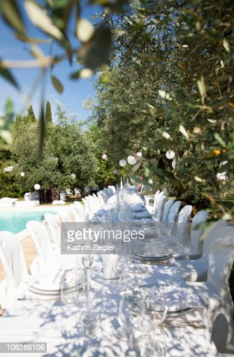 Festive Banquet Table Setting In Olive Garden Stock Photo