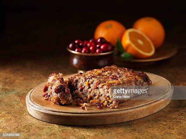 Festive Christmas ingredients of pork, cranberry & orange stuffing on chopping board