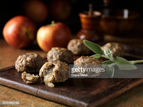 Festive Christmas ingredients of pork, sage and onion stuffing balls with apple sauce centres. Apples and sage