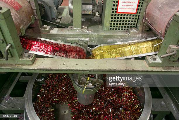 Festive employee makes tinsel in the factory area of the Festive Productions Ltd premises on December 10 2013 in Cwmbran Wales Although Christmas Day...