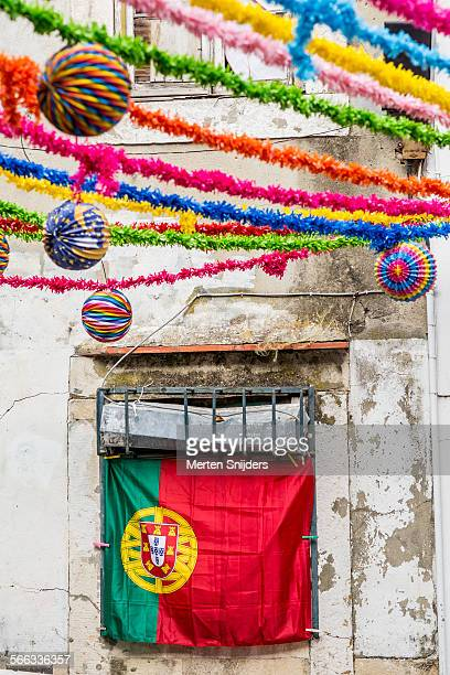 Festive garlands and flag in Alfama