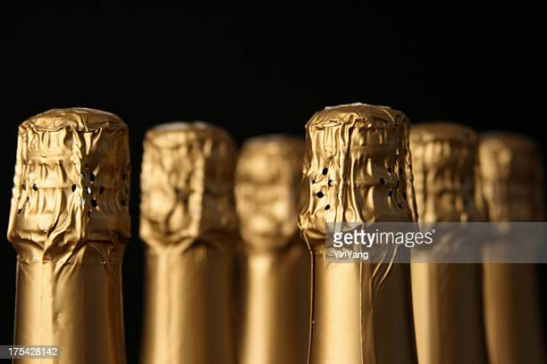 Festive Gold Foil Champagne Bottles for Celebration in Black Background