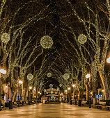 Christmas lights at night in Palma de Mallorca, illuminated Passeig des Born Avenue.