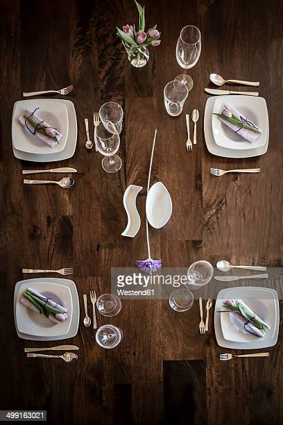 Festive laid table for four persons, elevated view