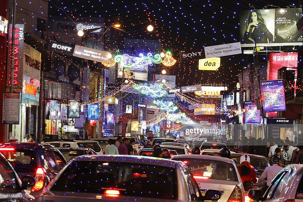 Festive lights illuminate traffic and pedestrians in the Brigade Road shopping area in central Bangalore India on Wednesday Jan 8 2014 India's...