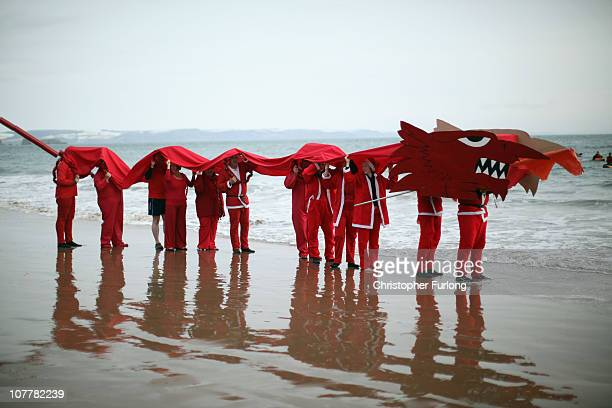 Festive revellers participate in the Tenby Big Red Boxing Day Dip on December 26 2010 in Tenby United Kingdom In it's 40th year of operation up to...