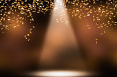 shower of golden confetti on festive stage
