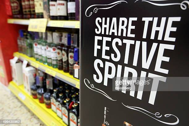 A festive sign hangs near to the alcoholic spirits for sale at the Tesco Basildon Pitsea Extra supermarket operated by Tesco Plc in Basildon UK on...