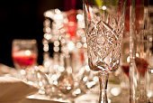 A festive dinner table setting complete with crystal stemware and candles