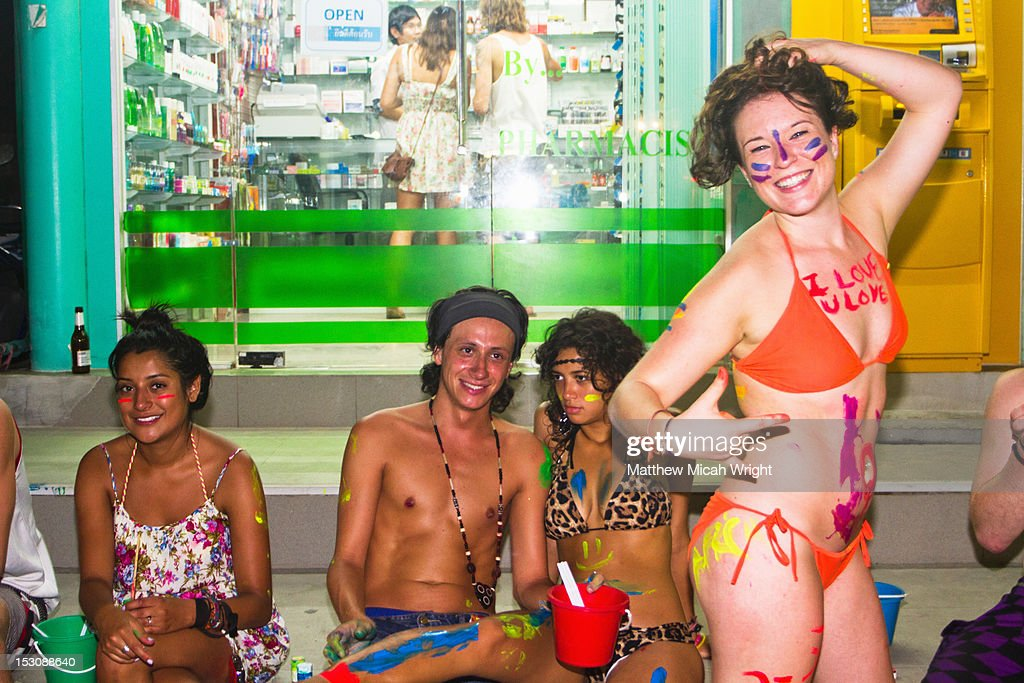 Festive travelers get painted. : Stock Photo