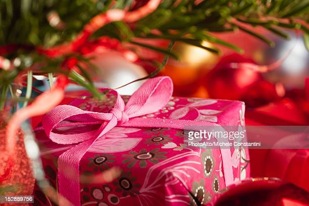 Festively wrapped Christmas gift, cropped