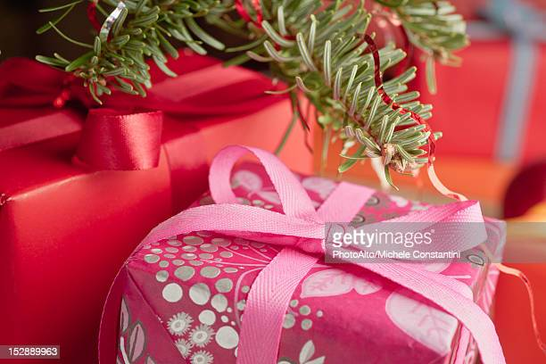 Festively wrapped Christmas gifts, close-up