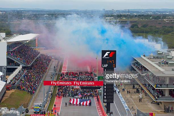Festivities and a cloud of of red white and blue smoke is released before the United States Formula One Grand Prix and the championship at Circuit of...