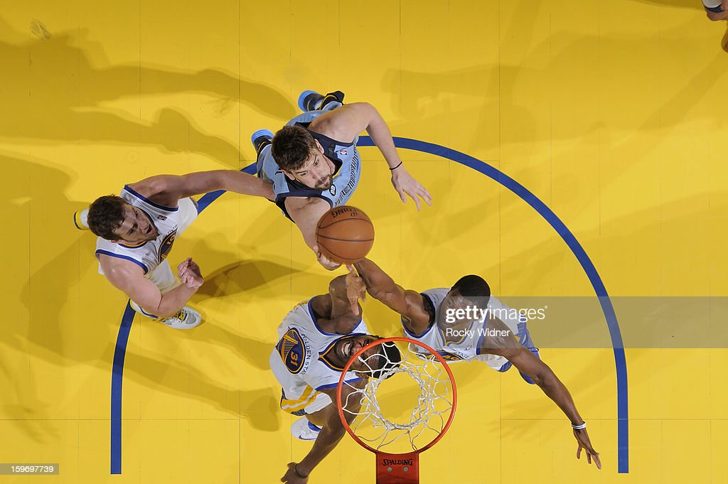 <a gi-track='captionPersonalityLinkClicked' href=/galleries/search?phrase=Festus+Ezeli&family=editorial&specificpeople=5725219 ng-click='$event.stopPropagation()'>Festus Ezeli</a> #31 and <a gi-track='captionPersonalityLinkClicked' href=/galleries/search?phrase=Harrison+Barnes&family=editorial&specificpeople=6893973 ng-click='$event.stopPropagation()'>Harrison Barnes</a> #40 of the Golden State Warriors rebounds against Marc Gasol #33 of the Memphis Grizzlies on January 9, 2013 at Oracle Arena in Oakland, California.