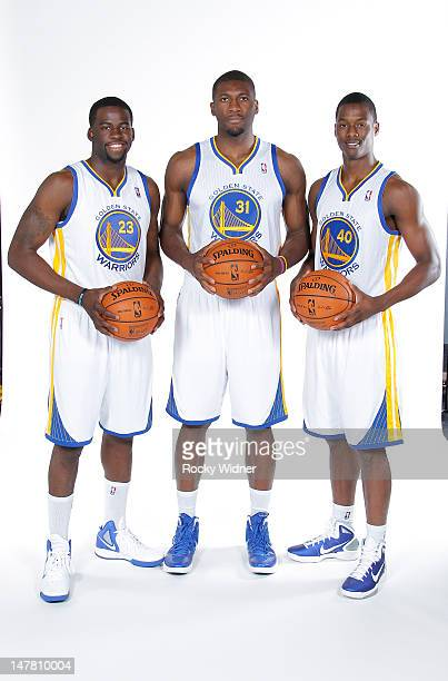 Festus Ezeli Harrison Barnes and Draymond Green of the Golden State Warriors poses for a photo at the Warriors draft pick press conference on July 2...