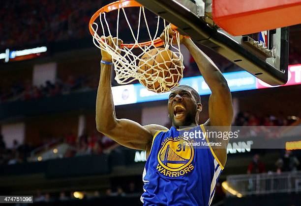 Festus Ezeli of the Golden State Warriors dunks against the Houston Rockets in the third quarter during Game Four of the Western Conference Finals of...