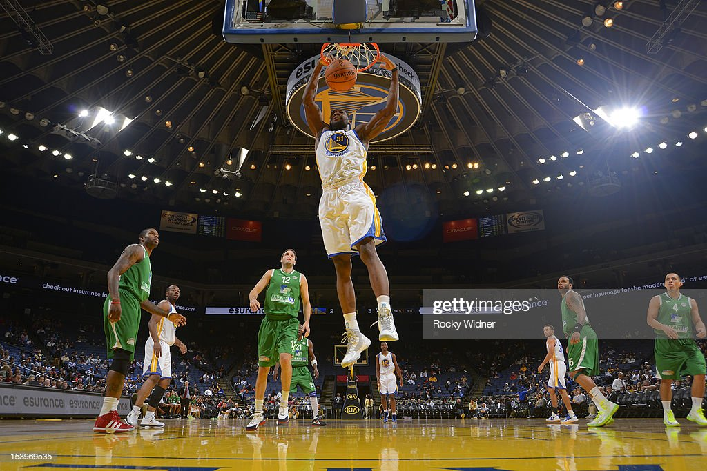 <a gi-track='captionPersonalityLinkClicked' href=/galleries/search?phrase=Festus+Ezeli&family=editorial&specificpeople=5725219 ng-click='$event.stopPropagation()'>Festus Ezeli</a> #31 of the Golden State Warriors dunks against the Maccabi Haifa on October 11, 2012 at Oracle Arena in Oakland, California.