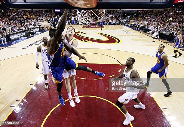 Festus Ezeli of the Golden State Warriors dunks against Timofey Mozgov of the Cleveland Cavaliers in the second half during Game Six of the 2015 NBA...