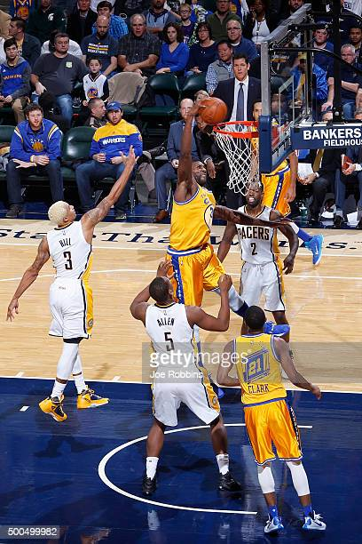Festus Ezeli of the Golden State Warriors dunks the ball against Lavoy Allen and George Hill of the Indiana Pacers in the first half of the game at...