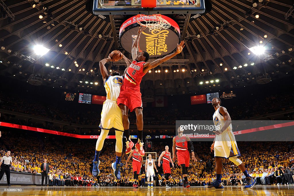 Festus Ezeli of the Golden State Warriors goes for the layup during the game against AlFarouq Aminu of the Portland Trail Blazers in Game Five of the...