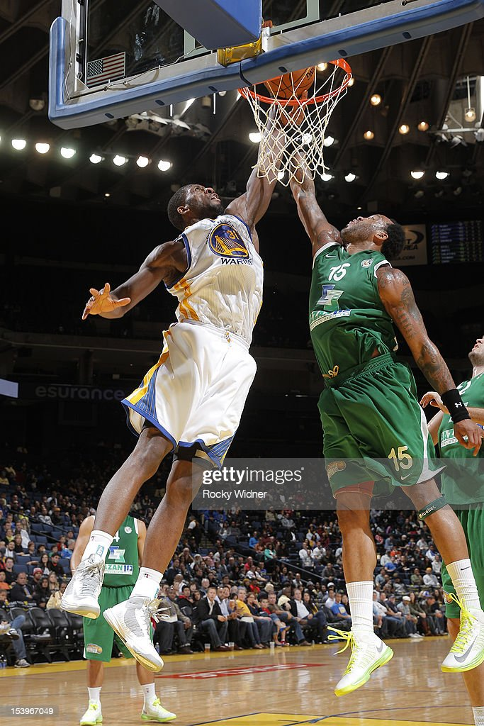 <a gi-track='captionPersonalityLinkClicked' href=/galleries/search?phrase=Festus+Ezeli&family=editorial&specificpeople=5725219 ng-click='$event.stopPropagation()'>Festus Ezeli</a> #31 of the Golden State Warriors goes to the basket against <a gi-track='captionPersonalityLinkClicked' href=/galleries/search?phrase=James+Thomas+-+Basketball+Player&family=editorial&specificpeople=11519617 ng-click='$event.stopPropagation()'>James Thomas</a> #15 of the Maccabi Haifa on October 11, 2012 at Oracle Arena in Oakland, California.