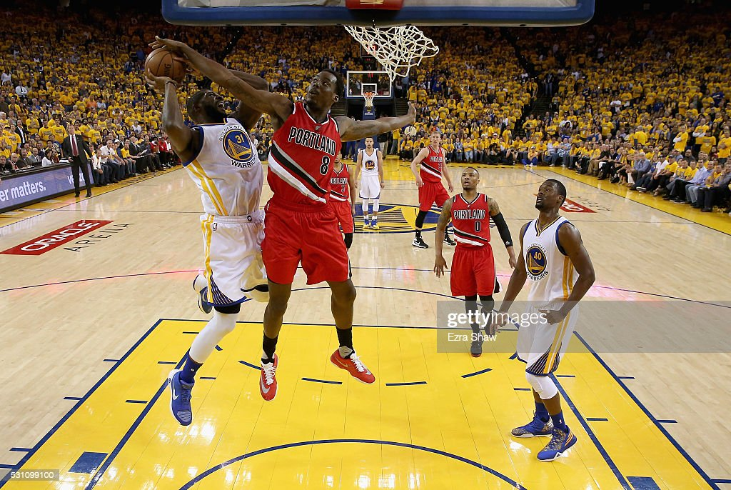 Festus Ezeli of the Golden State Warriors goes up for a shot against AlFarouq Aminu of the Portland Trail Blazers during Game Five of the Western...