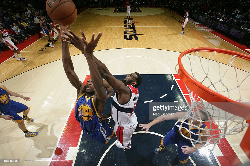 <a gi-track='captionPersonalityLinkClicked' href=/galleries/search?phrase=Festus+Ezeli&family=editorial&specificpeople=5725219 ng-click='$event.stopPropagation()'>Festus Ezeli</a> #31 of the Golden State Warriors grabs the rebound against <a gi-track='captionPersonalityLinkClicked' href=/galleries/search?phrase=Chris+Singleton&family=editorial&specificpeople=241555 ng-click='$event.stopPropagation()'>Chris Singleton</a> #31 of the Washington Wizards on December 8, 2012 at the Verizon Center in Washington, DC.