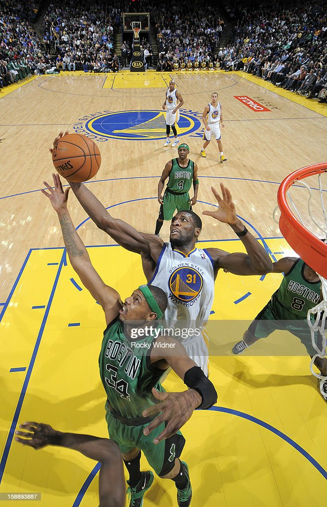 Festus Ezeli #31 of the Golden State Warriors grabs the rebound against Paul Pierce #34 of the Boston Celtics on December 29, 2012 at Oracle Arena in Oakland, California.