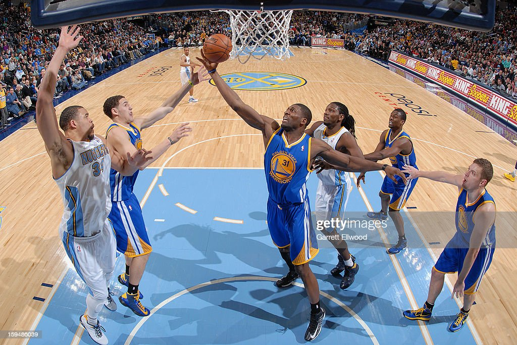 <a gi-track='captionPersonalityLinkClicked' href=/galleries/search?phrase=Festus+Ezeli&family=editorial&specificpeople=5725219 ng-click='$event.stopPropagation()'>Festus Ezeli</a> #31 of the Golden State Warriors grabs the rebound against the Denver Nuggets on January 13, 2013 at the Pepsi Center in Denver, Colorado.