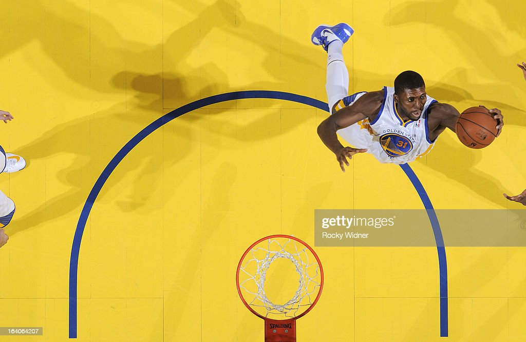 <a gi-track='captionPersonalityLinkClicked' href=/galleries/search?phrase=Festus+Ezeli&family=editorial&specificpeople=5725219 ng-click='$event.stopPropagation()'>Festus Ezeli</a> #31 of the Golden State Warriors rebounds against the New York Knicks on March 11, 2013 at Oracle Arena in Oakland, California.