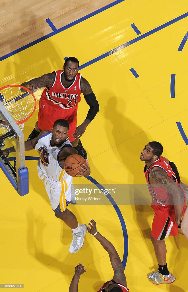 <a gi-track='captionPersonalityLinkClicked' href=/galleries/search?phrase=Festus+Ezeli&family=editorial&specificpeople=5725219 ng-click='$event.stopPropagation()'>Festus Ezeli</a> #31 of the Golden State Warriors rebounds against the Portland Trail Blazers on January 11, 2013 at Oracle Arena in Oakland, California.