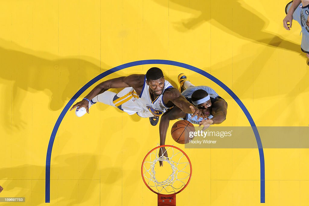 <a gi-track='captionPersonalityLinkClicked' href=/galleries/search?phrase=Festus+Ezeli&family=editorial&specificpeople=5725219 ng-click='$event.stopPropagation()'>Festus Ezeli</a> #31 of the Golden State Warriors rebounds against <a gi-track='captionPersonalityLinkClicked' href=/galleries/search?phrase=Zach+Randolph&family=editorial&specificpeople=201595 ng-click='$event.stopPropagation()'>Zach Randolph</a> #50 of the Memphis Grizzlies on January 9, 2013 at Oracle Arena in Oakland, California.