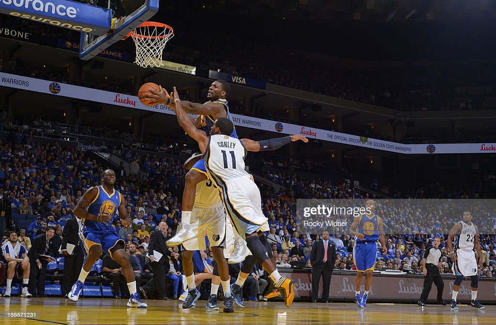 <a gi-track='captionPersonalityLinkClicked' href=/galleries/search?phrase=Festus+Ezeli&family=editorial&specificpeople=5725219 ng-click='$event.stopPropagation()'>Festus Ezeli</a> #31 of the Golden State Warriors shoots the ball against Mike Conley #11 of the Memphis Grizzlies on November 2, 2012 at Oracle Arena in Oakland, California.