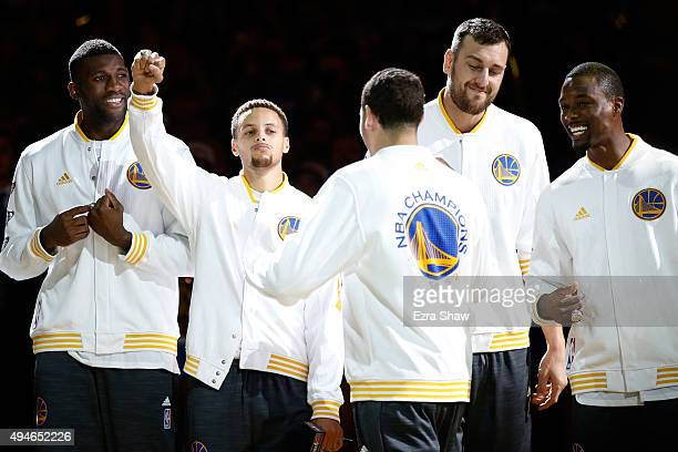 Festus Ezeli Stephen Curry Klay Thompson Andrew Bogut and Harrison Barnes of the Golden State Warriors celebrate after receiving their championship...