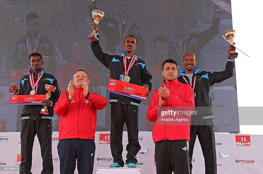 Fetene Alemu Regasa (winner, C), 2nd placed Sulti Gure Timbre (L) and 3rd placed Kefyalew Seid Burise (R) hold up their trophies during an award ceremony for Men's Division of the Vodafone Istanbul Half Marathon on April 27, 2014 in Istanbul, Turkey. The 21.1-kilometer race organized by Istanbul Metropolitan Municipality, began at the Old Galata Bridge in Balat, make a turn at Eyüp Hospital toward Kumkapi Fish Market and end in Balat at the same place it started.