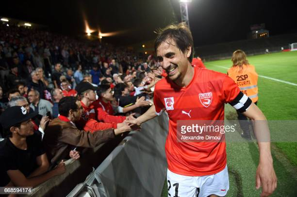 Fethi Harek of Nimes celebrates the victory with fans during the Ligue 2 match between Nimes Olympique and Us Orleans on April 14 2017 in Nimes France