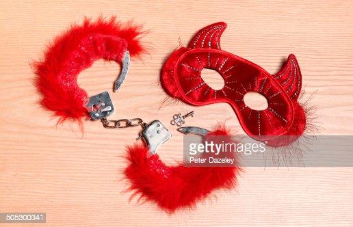 Fetisch mask and handcuffs