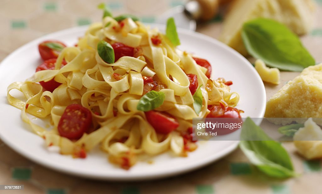 Fettuccine Basil & Sundried Tomatoes wit Parmeson  : Stock Photo