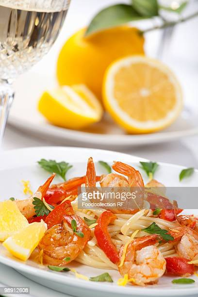 Fettuccine with prawns, lemons and red pepper, close-up