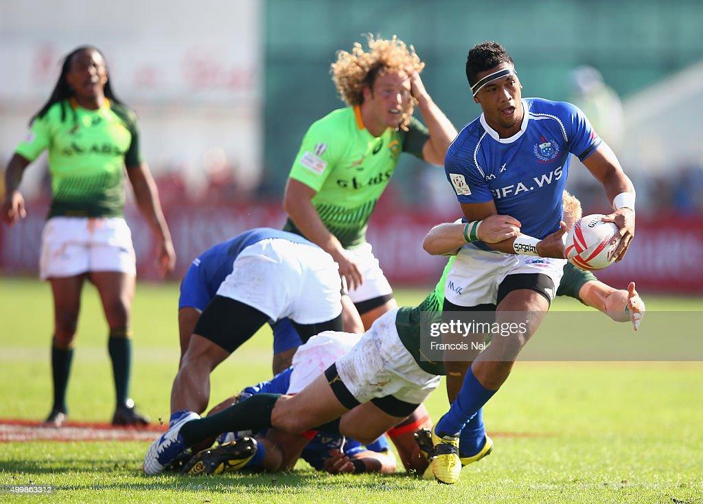 Fetufao Setu Laga of Samoa is tackled by Werner Kok of South Africa during the Emirates Dubai Rugby Sevens HSBC Sevens World Series on December 4...