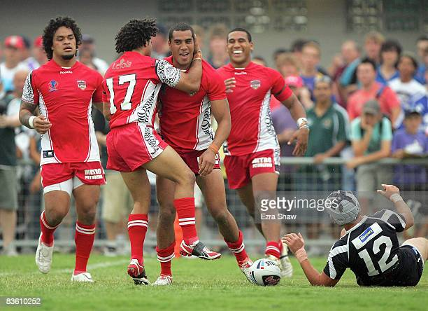 Fetuili Talanoa of Tonga is congratulated by teammates after he scored a try during the 2008 Rugby League World Cup ranking match between Scotland...
