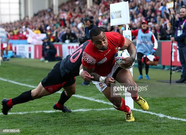 Fetu'u Vainikolo of Tonga scores a try as Lasha Malaguradze of Georgia tries to intercept during the Group C Rugby World Cup match between Tonga and...