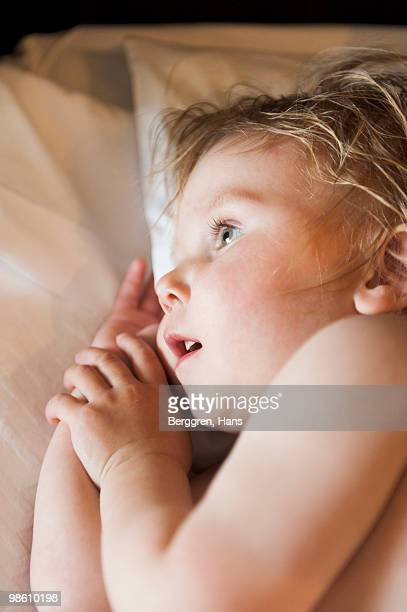 Feverish boy lying in bed, Sweden.