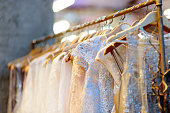 A few beautiful wedding dresses on a hanger. Bridal shop.