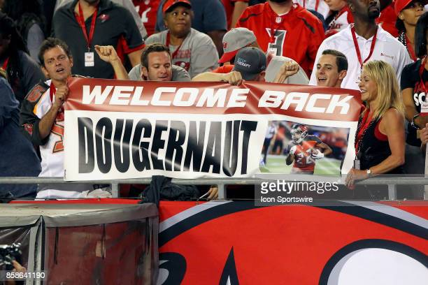 A few fans hold up a banner for support for Doug Martin of the Buccaneers during the NFL Regular game between the New England Patriots and the Tampa...