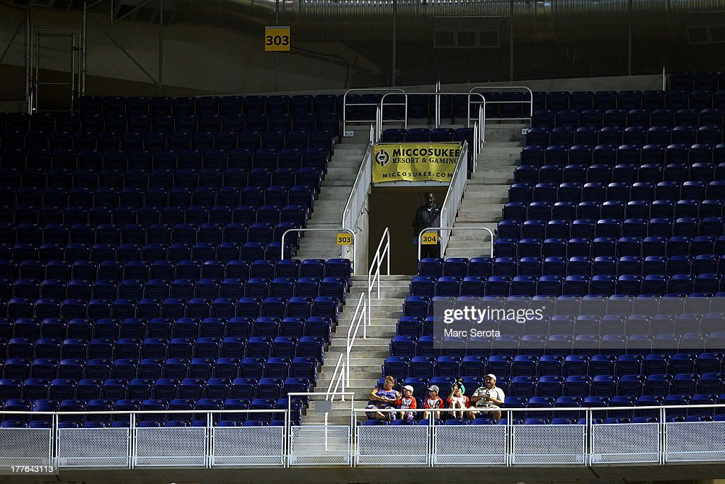 Few fans in the upper deck watch as the Colorado Rockies play against the Miami Marlins at Marlins Park on August 25, 2013 in Miami, Florida.